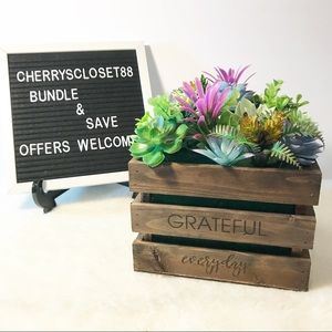 Faux cactus in a wooden crate